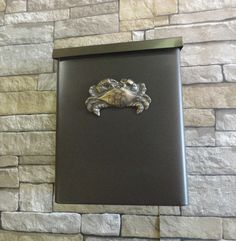 """This listing features our stunning and sturdy metal locking security wall mounted Sea Life inspired mailbox shown in our elegant Oil Rubbed Bronze and Bronze finish.    This mailbox measures 12.5"""" tall x 9.62"""" wide x 4.37"""" deep and comes in BRONZE ONLY with the option of a BRONZE OR SILVER top.  The Crab embellishment is available in;  Oil Rubbed Bronze & Bronze  Oil Rubbed Bronze & Platinum  Black & Bronze  Black & Platinum  Oil Rubbed Bronze and Blue Patina Bronze  Oil Rubbed Bronze and…"""