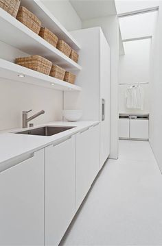 Color: 25 Fabulous All-White Rooms This minimalist kitchen is immaculate.This minimalist kitchen is immaculate. Laundry Mud Room, Kitchen Remodel, Kitchens Bathrooms, White Rooms, Minimalist Kitchen, Modern Laundry Rooms, Minimalist Kitchen Design, Kitchen Design, All White Room