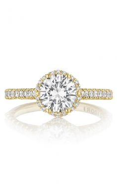 ($4890) Tacori yellow gold engagement ring. A big diamond look for the Tacori Girl who knows what she wants. A round center diamond blooms with a heart-shaped gallery that provides more windows of light to make your diamond sparkle. #tacori #yellowgold #gold #diamond #engagementring