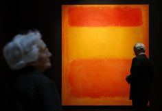 "A visitor looks at ""Orange, Red, Yellow"" by Mark Rothko, displayed at Sotheby's auctioneers in London April 14, 2008. Photo by Alessia Pierdomenico."