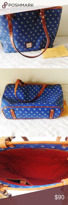 """Dooney & Bourke blue handbag 💯 authentic * comes w/ authenticity card  * exterior is in perfect condition but interior does have a few pen marks * 15"""" L x 10"""" H * interior zipper w/ three flap pockets and inside zip pocket  ❌ no trades  ❣️offers welcome! Dooney & Bourke Bags Shoulder Bags"""