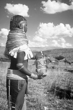 Africa | Ntwane girl proudly holding her 'Gymwane' doll | Photographer and date unknown