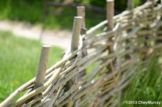 """""""Wattle fencing"""" is a building style where branches are woven in between the poles. This kind of fence can be made in a day, but is obviously less long-lasting then a stone work fence.  Walls for an animal stable can also be made in this fashion, and sometimes was, but had to be covered in a dung and straw mixture to plug the holes."""