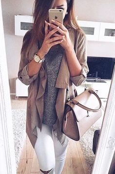 White jeans, grey shirt, and tan jacket