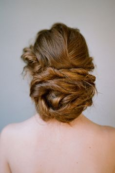 braided and twisted messy bun updo