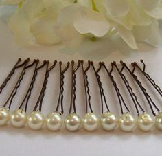 Wire pearls onto bobbi pins.