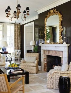 When your sunroom gets a lot of light, you can screw light colors and florals and paint that bad boy a deep dark glossy brown. It helps if you're the ridiculously talented duo of architect Gil Schafer and interior designer David Netto.