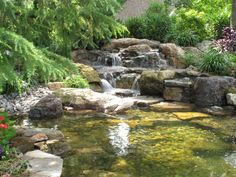 water features waterfalls, outdoor living, ponds water features, Big Boulders are the key to help naturalize man made waterfalls this is one of my favorites Learn more about our waterfall construction click on this link