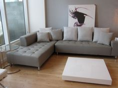 help me my pinteresting friends! i want to find a grey leather couch but preferably not loose pillow backed or tufted...