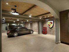 Arizona Mega Mansion : Large custom luxury garage interior with wood-beamed ceiling and brick wall.