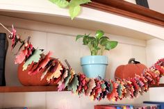 "Jeanna Bohanon: ""This garland will be lovingly placed on the front of my hutch so that I can try to recreate the feeling of fall here in my home, and if I had a fireplace, it would be adorning my mantel. I would love to see the firelight dance off of the Champagne Glimmer Paper leaves. Although it looks extremely time consuming, it came together in just a few hours, so it would make a great weeknight project."" http://www.facebook.com/photo.php?fbid=10151207678357512"