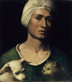 Portrait of a young man holding a dog and cat  Attributed to Dosso Dossi (1486 - 1541)