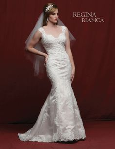 Regina Bianca  Style #RB1226  Chic beaded lace and tulle over satin fit and flare gown has a sweetheart neckline with wide cap sleeves. There are beads, crystals and pearls sewn throughout the gown. The back has double lace straps and covered buttons over the zipper. There is a sweep train.