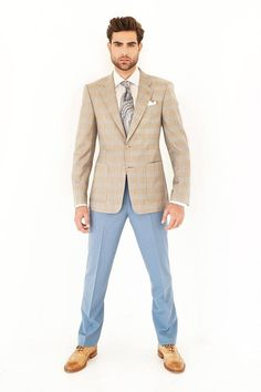 Custom tan with pink windowpane sports coat paired with cream dress slacks and a light blue and white striped custom dress shirt.