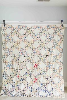 Antique Ocean Waves quilt top made from scrappy half squares triangles.