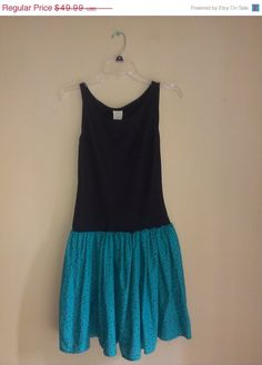Check out this item in my Etsy shop https://www.etsy.com/listing/200623873/70-summer-sale-vintage-1970s-teal-black