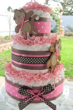 Diaper Cake, you can do something similar for a boy, just use blue. Use yellow or both blue and pink if you are not reveling the gender