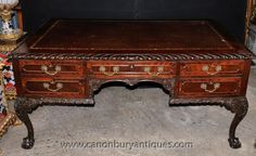 - Stunning Chippendale style mahogany desk<BR> - We date this important piece to circa 1920<BR> - Great look to it, fab mahogany patina and detailed carvings<BR> - Classic Chippendale motifs include the pie crust trim, ball and claw feet and intricte moulding<BR> - Very solid and chunky<BR> - Ample storage with five drawers to front, great for home office set up<BR> - Please come and view in our North London / Hertfordshire antiques showroom, open to the public<BR> - We ship to every corner…