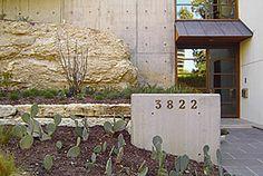 Entry, landscape, concrete walls