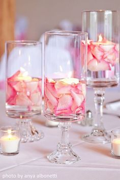 This one would be super easy, float rose petals to match your colors and a floating candle.  Vases are from dollar tree--we already have loads of candlesticks to glue on the bottom.