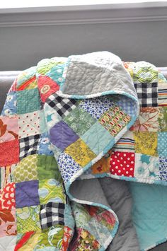 orange you glad: potluck quilts ..... love the black&white Gingham scraps mixed with the colorful scraps