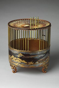 """Japanese Bird Cage 18th C. Black lacquer, gold and silver maki-e, silk netting. Cranes and poems refer to Wakanoura, revered as the """"Bay of Poetry."""""""