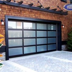 Double Garage Design Ideas | Glass garage door, Brick exteriors and ...