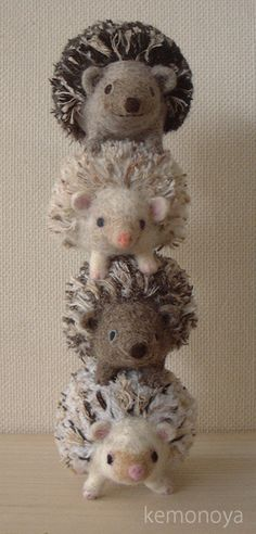 Hedgehogs! Without going back to check, I'd say the prickles on his back could be made with thin yarn. I like the idea, anyway!
