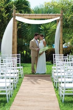 beach theme wedding alter   ... breeze teases the linen wrapped in the eco-friendly bamboo altar