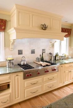 Idea Of The Day Traditional Antique White Kitchen With A Large Wood Range Hood Over Professional Top Cabinetry And By Crown Point