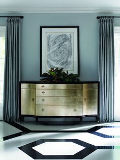 Black and gold refined. Elegant six drawer storage cabinet with two doors. Versatile as a dresser or dining credenza. Featuring aged leaf silver finish with