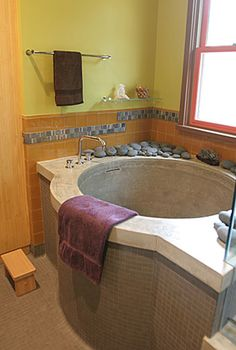 japanese soaking tubs for small bathrooms | The frameless shower enclosure is roughly 5 ft. by 7 ft. and features ...