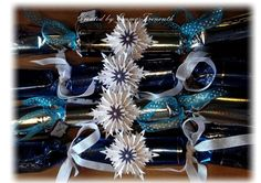 Handmade Christmas crackers, blue and silver theme, Tim Holtz snowflake rosette to decorate.