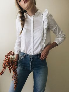 White ruffle shirt http://ladieshighheelshoes.blogspot.com/2016/01/trends-of-high-heel.html