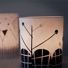 Free Printable DIY project for candle lovers. The graphic look of these covers will turn your generic glass holders into a fun wintry scene.