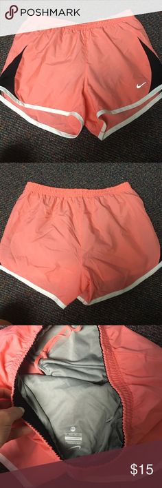 Nike women's athletic shorts Comfortable pink nike athletic shorts. Pink with black and white details. Built in underwear. Never been worn. Nike Shorts