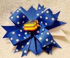 4.5 Inch Boutique Hair Bow Royal Blue & White Polka Dot with White Grosgrain Ribbon on a Pinwheel Base Resin Book Stack Embellishment Covered Metal Alligator Clip with Slip Resist Pad This is an adora