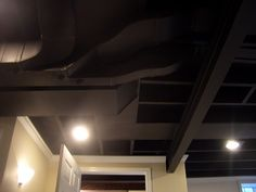 LOVE the way they painted this basement ceiling black, and then drywalled and put crown moulding. Looks so sharp! Great way to finish a basement ceiling!
