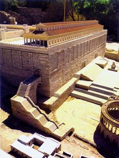 Southern retaining wall of the Herodian Temple mount.  The stairs led up to the court of the gentiles.  The red-roofed basilica is called the Royal Stoa.   (Model, Holy Land Hotel, Jerusalem)