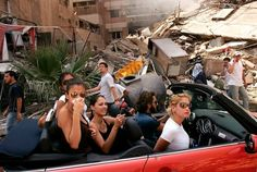 2007 Young Lebanese drive down a street in Haret Hreik, a bombed neighborhood in southern Beirut. (Spencer Platt)