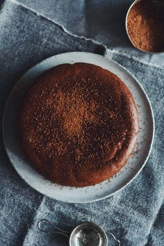 Do you ever crave a cake that is dense, dark and deeply satisfying? Today I  am sharing just that. This is my Flourless Expresso Chocolate Cake. We are  dark chocolate addicts at my place, going through record amounts each week.  Feeding this addiction by developing recipes with more of this ingredient  may not be the best idea but it sure tastes delicious! This is the kind of  cake that can sit in the fridge all week, be re-heated in the oven and  still taste great. Serve with ice cream or…