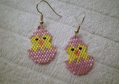 These cute Easter Chick in a Pink Egg dangle earrings are handmade with #11 Japanese Delica Beads in the Peyote stitch. The chick is yellow and is