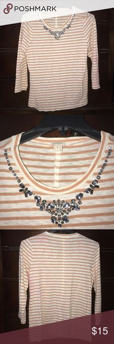 J Crew Striped Long Sleeve Top 3/4 Length Size L This listing is for a used J. Crew striped orange and white shirt! It has a built in necklace so you will look stylish without having to put any effort in :) It does have some pink stains on it, all of which are shown in the pictures. I have not tried to get the stains out, but with a stain remover they may come out! This shirt is size large and can have a baggy fit a small figure or a form-fitting look in a larger figure! If you have any…