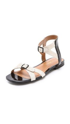 Two-tone 3.1 Phillip Lim sandals in an exotic mix of scale texture and glossy patent leather. Cutouts detail the straps, which close with buckles at the vamp and the ankle. Leather sole.