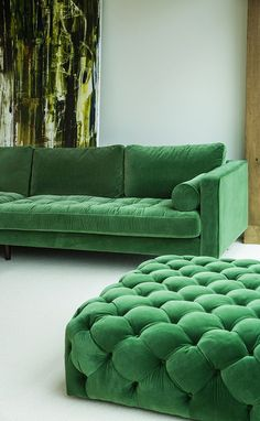 Emerald green sofa and tufted ottoman