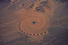 """These strange cones and holes look like a bizarre wind formation in the Egyptian desert, until you see the pattern they make from the air. By Greek artist Danae Stratou and the DAST art team, mid-1990s, this earthwork art is called """"Desert Breath.""""Covers 100,000 square meters in the Egyptian desert near the Red Sea, took several years to create. At its center was a fairly deep pool of water, the whole project was designed to slowly erode over time. Which is exactly what's happened"""
