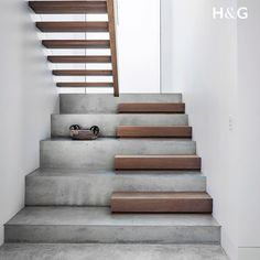 An opaque full-height window illuminates this beautifully simple thoroughfare. The stairs are polished concrete with European oak treads, stained to match the ground floor. styling by and photographed by stairs Home Stairs Design, Interior Stairs, Home Interior Design, Concrete Stairs, Concrete Floors, Concrete Houses, Concrete Garden, Stairs Architecture, Interior Architecture