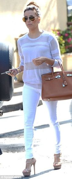 Eva Longoria in white ensemble with nude heels and cognac Hermes Birkin