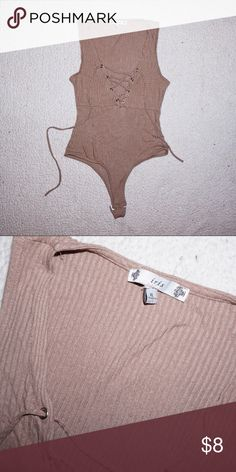 Nude Lace Up Body Suit Great condition only worn once. Snap crotch and lace up top. Size XL but fits like a M-L. Not UO just using for exposure. Urban Outfitters Tops
