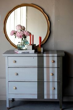 dresser redo...love the stripes on just the one side.
